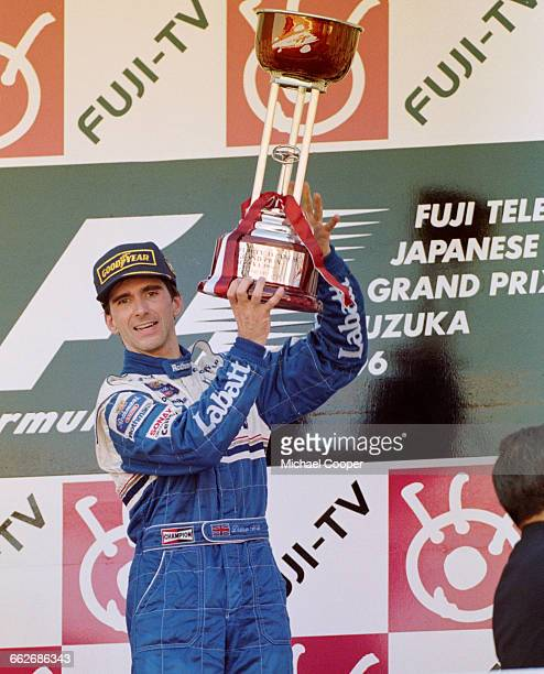 Damon Hill of Great Britain and driver of the#5 Rothmans Williams Renault Williams FW18 Renault RS8 V10 celebrates winning the race and the World...