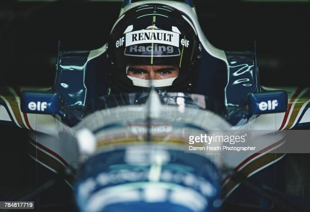 Damon Hill of Great Britain and son of former two time Formula 1 world champion Graham sits aboard the Rothmans Williams Renault Williams FW18...