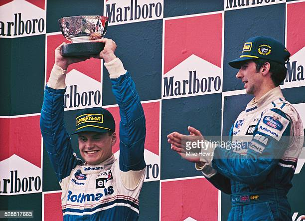 Damon Hill of Great Britain, driver of the Rothmans Williams Renault Williams FW16B Renault V10 congratulates his second placed team mate David...
