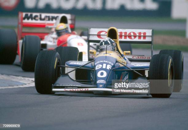 Damon Hill of Great Britain, driving a Williams FW15C with a Renault RS5 3.5 V10 engine for Canon Williams Renault, enroute to placing second during...