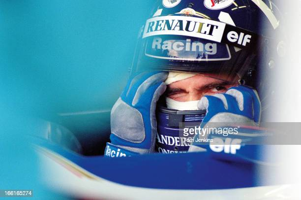 Damon Hill of Great Britain, waits in his Williams Formula One car during qualifying practice for the 1995 British Grand Prix at the Silverstone...