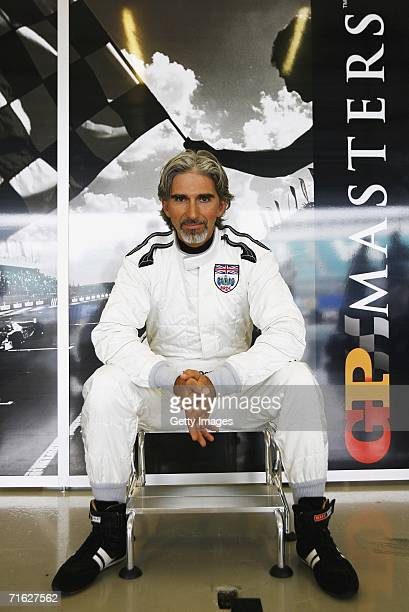 Damon Hill poses in the garage during testing for the GP Masters of Great Britain at Silverstone Circuit on August 10 in Silverstone England