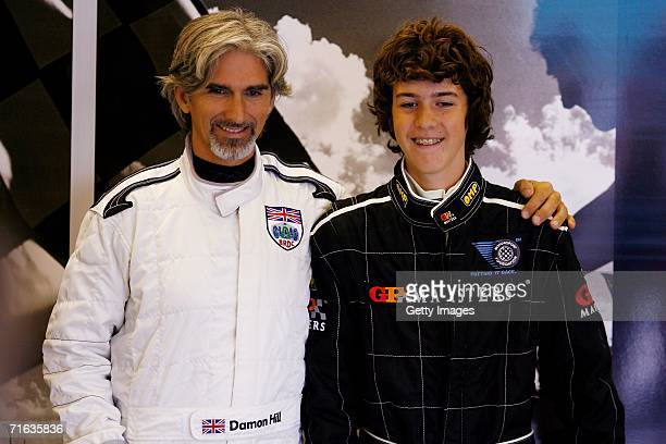 Damon Hill poses with his son Josh Hill during the GP Masters of Great Britain at Silverstone circuit on August 12 in Silverstone England