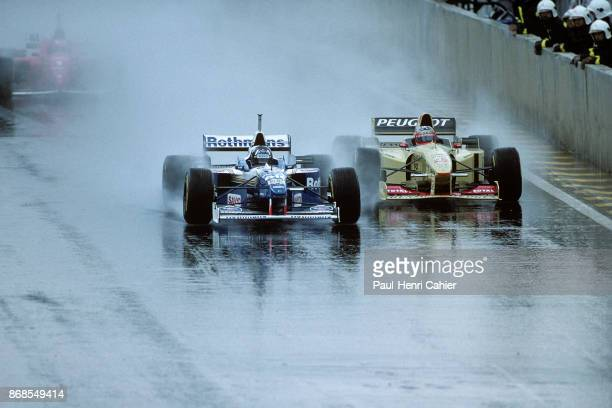 Damon Hill, Rubens Barrichello, Williams-Renault FW18, Jordan-Peugeot 196, Grand Prix of Brazil, Autodromo Jose Carlos Pace, Interlagos, 31 March...