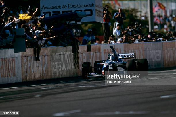 Damon Hill WilliamsRenault FW18 Grand Prix of Japan Suzuka Circuit 13 October 1996 Damon Hill raises his arm as he crosses the start finish line and...