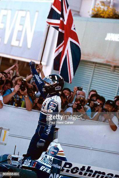 Damon Hill, Williams-Renault FW18, Grand Prix of Japan, Suzuka Circuit, 13 October 1996. Damon Hill raises his arm after the finish of the1996 Grand...
