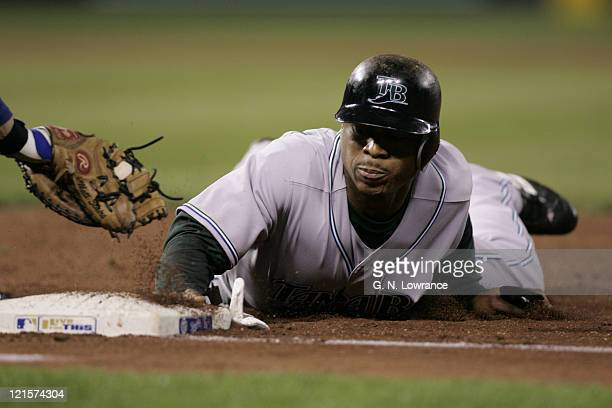 Damon Hollins of the Tampa Bay Devil Rays slides back into first base to avoid a tag against the Kansas City Royals at Kauffman Stadium in Kansas...