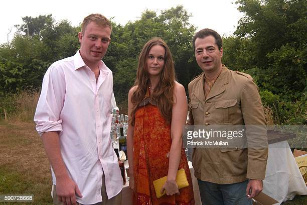 Damon Johnson Jasmin Levet and Doug Dechert attend Junko Yoshioka Presents Her Evening Wear Collection at Peter and Nejma Beard Residence on July 16...