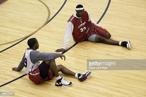 Damon Jones and LeBron James of the Cleveland Cavaliers talk as they stretch before practice at Quicken Loans Arena on October 22, 2005 in Cleveland,...