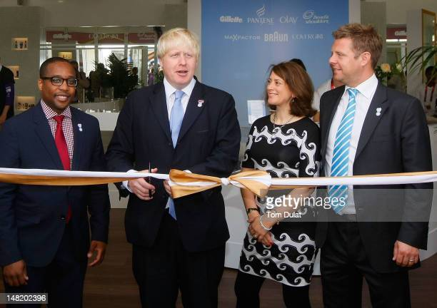 Damon Jones, Boris Johnson, Kathryn Davies and Nathan Homer cut the ribbon during the opening of the P&G Salon at the Olympic Village on July 12,...