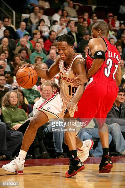Damon Jones of the Cleveland Cavaliers drives around Sebastian Telfair of the Portland Trail Blazers March 17 2006 at The Quicken Loans Arena in...