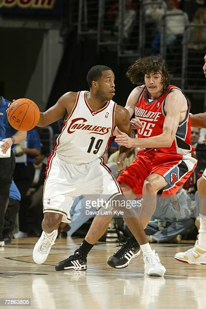 Damon Jones of the Cleveland Cavaliers is defended by Adam Morrison of the Charlotte Bobcats during the game at Quicken Loans Arena on December 13,...