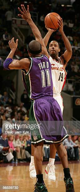 Damon Jones of the Cleveland Cavaliers shoots a jumper over TJ Ford of the Milwaukee Bucks January 7 2006 at The Quicken Loans Arena in Cleveland...