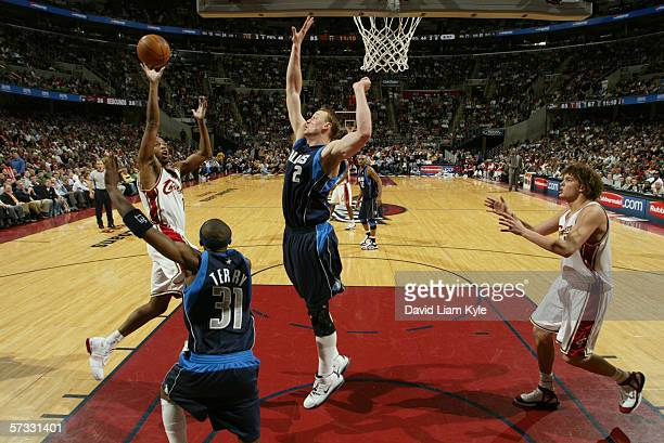 Damon Jones of the Cleveland Cavaliers shoots over Jason Terry and Dirk Nowitzki of the Dallas Mavericks during the game on March 29 2006 at The...