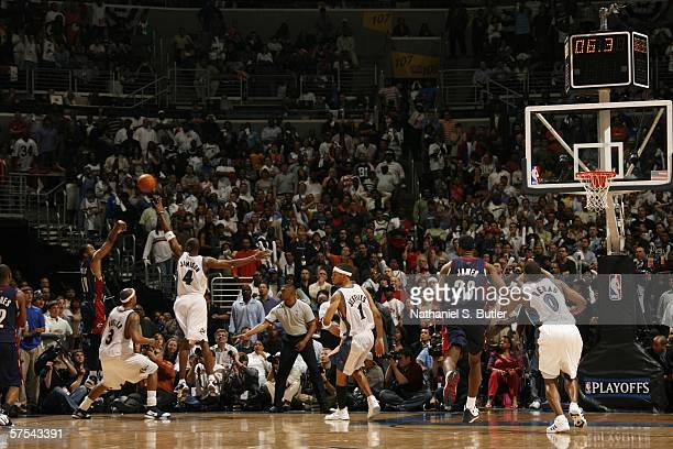 Damon Jones of the Cleveland Cavaliers shoots the game winning shot against Antawn Jamison of the Washington Wizards in game six of the Eastern...