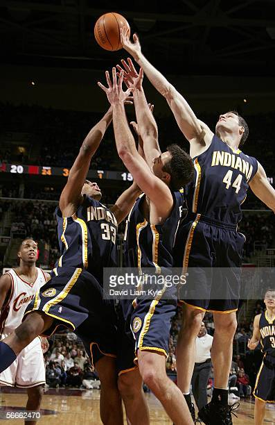 Damon Jones of the Cleveland Cavaliers watches as Jeff Foster, Danny Granger and Austin Croshere of the Indiana Pacers struggle for the ball January...
