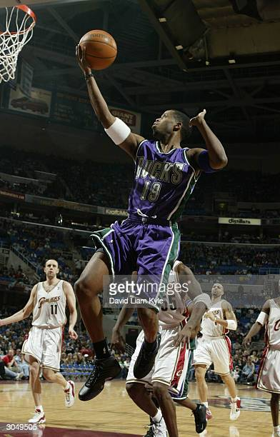 Damon Jones of the Milwaukee Bucks lays one in against the Cleveland Cavaliers at Gund Arena on March 6 2004 in Cleveland Ohio NOTE TO USER User...