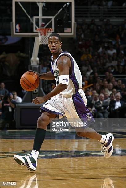 Damon Jones of the Milwaukee Bucks moves the ball against the Toronto Raptors during the game at Bradley Center on April 14 2004 in Milwaukee...