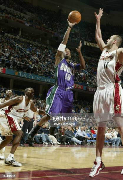 Damon Jones of the Milwaukee Bucks shoots against the Cleveland Cavaliers at Gund Arena on March 6 2004 in Cleveland Ohio NOTE TO USER User expressly...