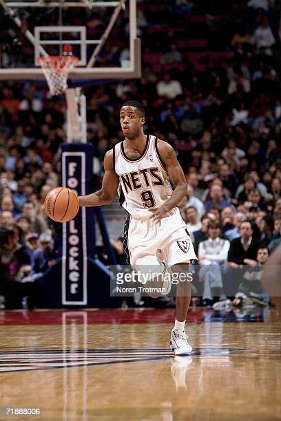 Damon Jones of the New Jersey Nets moves the ball up court during a game played in 1999 at the Continental Airlines Arena in East Rutherford New...