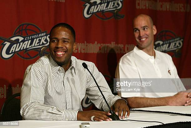 Damon Jones smiles as he and Danny Ferry attend a media conference to announce Jones' four year contract deal with the Cleveland Cavaliers on...
