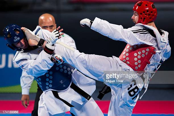 Damon Sansum of Great Britain beats Maksim Rafalovich of Uzbekistan during a Men's 80 kg combat of WTF World Taekwondo Championships 2013 at the...