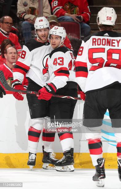 Damon Severson and Brett Seney of the New Jersey Devils celebrate after Severson scored against the Chicago Blackhawks in the first period at the...