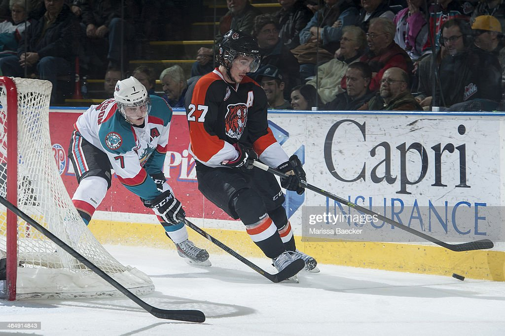 Damon Severson #7 of the Kelowna Rockets stick checks Dylan Bredo #27 of the Medicine Hat Tigers during the third period on January 24, 2014 at Prospera Place in Kelowna, British Columbia, Canada.