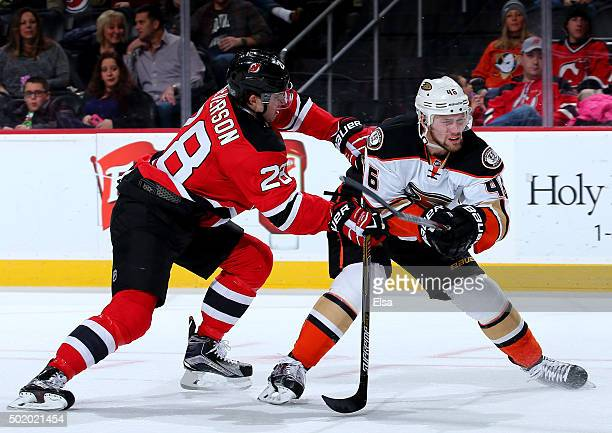 Damon Severson of the New Jersey Devils and Jiri Sekac of the Anaheim Ducks fight for position on December 19 2015 at Prudential Center in Newark New...