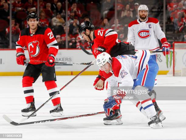Damon Severson of the New Jersey Devils skates against Ryan Poehling of the Montreal Canadiens during the second period on February 4 2020 in Newark...