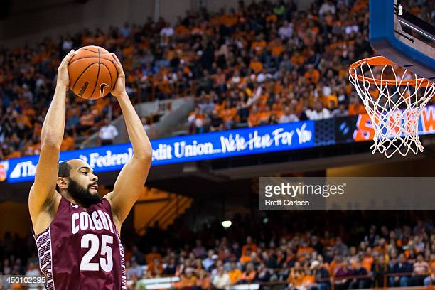 Damon ShermanNewsome of Colgate Raiders pulls down a first half rebound during a game against Syracuse Orange on November 16 2013 at the Carrier Dome...