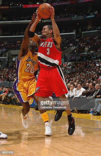 Damon Stoudamire of the Portland Trail Blazers attempts to put a shot up over Gary Payton of the Los Angeles Lakers during the game on February 17...