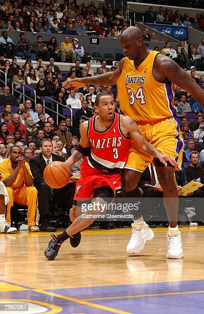 Damon Stoudamire of the Portland Trail Blazers drives past Shaquille O'Neal of the Los Angeles Lakers during the second half of action on February 17...