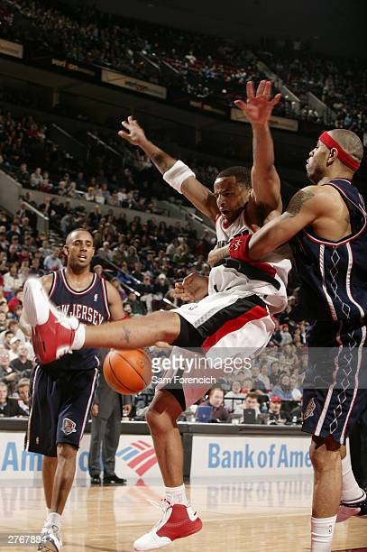 Damon Stoudamire of the Portland Trail Blazers gets fouled in the final seconds of a game against the New Jersey Nets on November 28 2003 at the Rose...