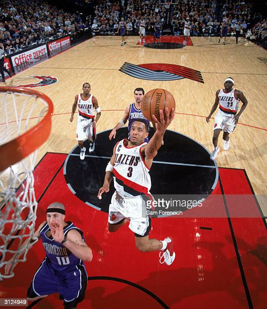 Damon Stoudamire of the Portland Trail Blazers goes up for a layup during the game against the Sacramento Kings at The Rose Garden on March 12 2004...