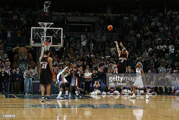 Damon Stoudamire of the Portland Trail Blazers hits a threepointer with 16 seconds left in overtime to give Portland the lead in an NBA game against...