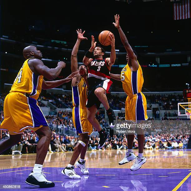 Damon Stoudamire of the Portland Trail Blazers shoots the ball against the Los Angeles Lakers on January 22 2000 at Staples Center in Los Angeles CA...