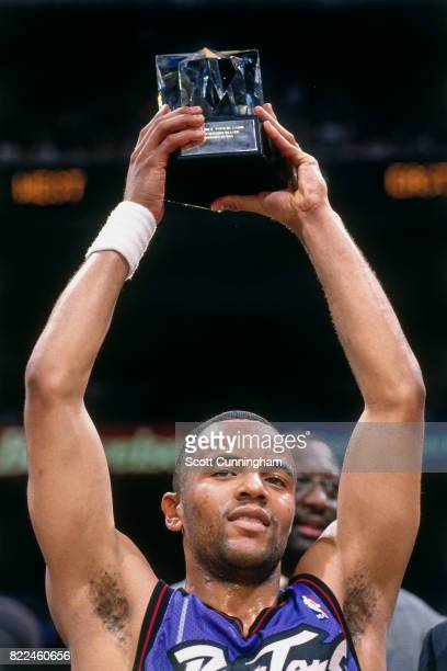 Damon Stoudamire of the Toronto Raptors celebrates winning the MVP award after the 1996 Rookie Challenge played February 10 1996 at the Alamodome in...