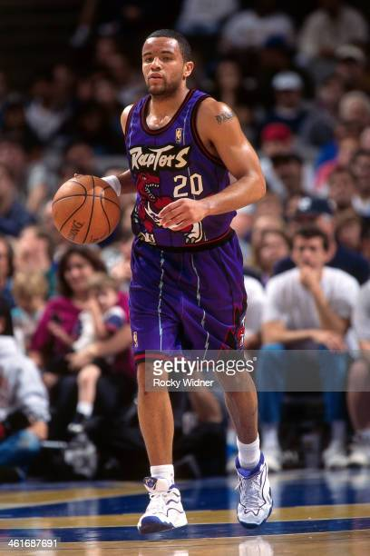 Damon Stoudamire of the Toronto Raptors dribbles the ball against the Golden State Warriors during a game played on March 15 1997 at the San Jose...