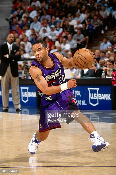 Damon Stoudamire of the Toronto Raptors dribbles the ball during a game played on March 3 1997 at Arco Arena in Sacramento California NOTE TO USER...