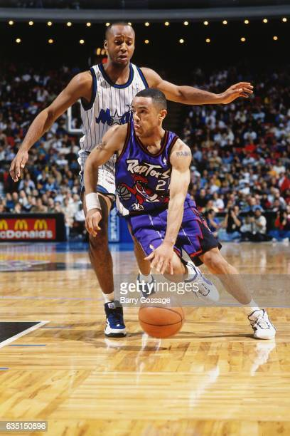 Damon Stoudamire of the Toronto Raptors drives against Brian Shaw of the Orlando Magic on January 3 1996 at the Orlando Arena in Orlando Florida NOTE...