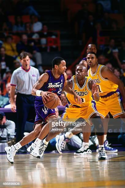 Damon Stoudamire of the Toronto Raptors drives against Nick Van Exel of the Los Angeles Lakers on November 30 1997 at The Forum in Inglewood...