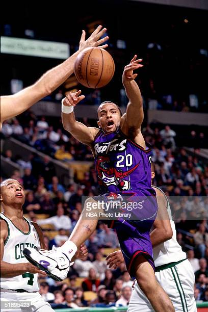 Damon Stoudamire of the Toronto Raptors makes a pass against the Boston Celtics during the NBA game in Boston Masachussetts NOTE TO USER User...