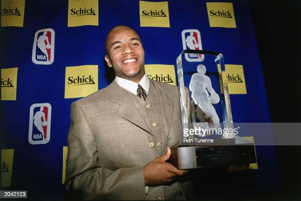 Damon Stoudamire of the Toronto Raptors poses for a portrait after receiving the Rookie of the Year Trophy on May 15 1996 in Toronto Canada NOTE TO...
