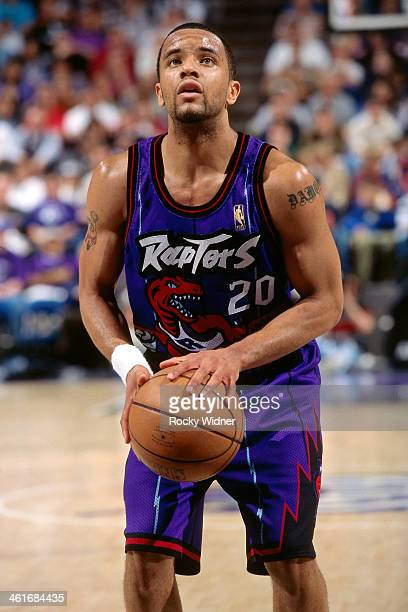 Damon Stoudamire of the Toronto Raptors shoots a foul shot during a game played on March 3 1997 at Arco Arena in Sacramento California NOTE TO USER...