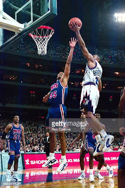 Damon Stoudamire of the Toronto Raptors shoots against the New Jersey Nets on November 3 1995 at the Toronto SkyDome on November 3 1995 in Toronto...