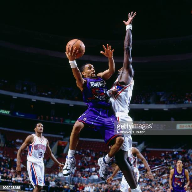 Damon Stoudamire of the Toronto Raptors shoots during a game played on January 29 1997 at the First Union Arena in Philadelphia Pennsylvania NOTE TO...