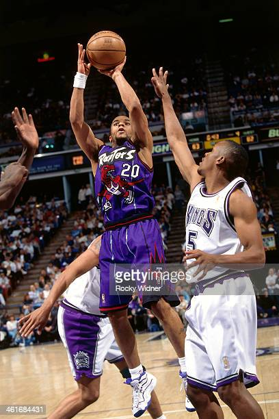 Damon Stoudamire of the Toronto Raptors shoots the ball during a game played on March 3 1997 at Arco Arena in Sacramento California NOTE TO USER User...