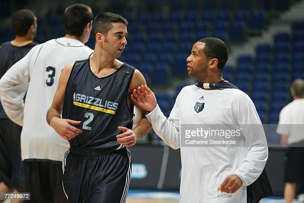 Damon Stoudamire talks to Juan Carlos Navarro during open practice of the Memphis Grizzlies during the EA Sports NBA Europe Live Tour at Palacio de...