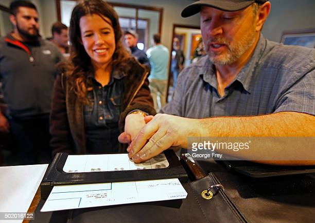 Damon Thueson records the fingerprints of Elyse Sprout at a gun concealed carry permit class put on by USA Firearms Training on December 19 2015 in...